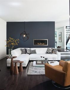 Note Gorgeous Grey Wall Color Great Light Fixture And Like The Warm Wood Accents Modern Living Room Medici Sectional Sofa With Track Arm