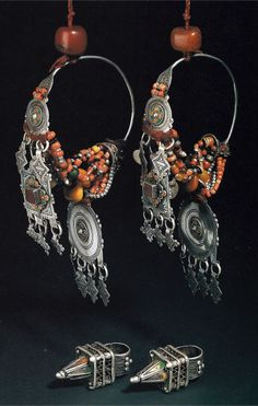 Morocco | Pair of woman's headdress pendants and at the bottom a pair of woman's hair ring ornaments | Silver, enamel, coral, amber, shells, glass beads || Ghysels Collection, photograph John Bigelow Taylor