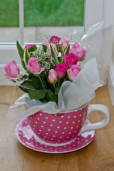 Bouquet of pink roses delivered in a giant spotty pink tea cup. This speaks to me of Valentine Day.
