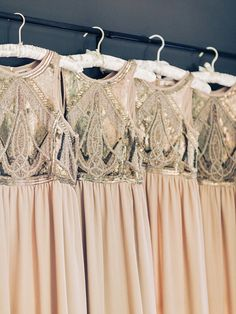 Peach and gold beaded bridesmaid dresses: http://www.stylemepretty.com/2016/08/19/rustic-foxhall-resort-wedding/ Photography: Amy Arrington - http://www.amyarrington.com/