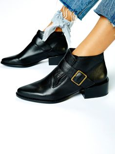 Avalon Menswear Boot   Easy and effortless ankle boot featuring a pointed toe and stacked square heel. Buckle detailing with metal hardware. Padded footbed for a comfortable fit.