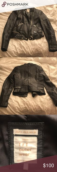 Zara trf Black leather biker jacket MINT condition 100% sheep leather Zara jacket! The leather is butter soft with no nicks or scratches. All four zipper pockets work perfectly, and the front can be worn zipped up for a more slick look, half-zipped, or open for a more casual look. I bought this in-store late last year and wore it max 3 times. So sad to let it go, but I'm a college student and my family is facing some harder times, so I'm paring down /saving up! Feel free to make an offer…