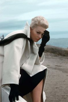 Love the black gloves with the white coat