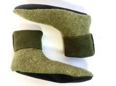"""Kids Large. Fits kids 6½ to 8 ½ years. Shoe size 13 ½ to 2½.  Wooly Wearables eco-friendly slippers are perfect for keeping toes warm at the cabin, a trip to grandma's house or just a lazy day at home. Lovingly created in Duluth, MN from recycled wool sweaters, these cozy, felted """"foot sweaters"""" are MACHINE WASHABLE and best of all they are NON ITCHY and all toddler, kids, and adult sizes have ToughTek NON-SLIP BOTTOMS.  You get the exact slippers pictured. A sage green boiled wool KIDS…"""