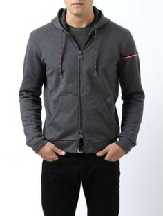 Moncler sweathshirt - Grey zipped hooded sweatshirt 100% cotton (col. cod. 988). Two front patch pockets. Knitted logo + band sewn on the left sleeve. Double slider zipper. Moncler Fall Winter 2013-2014 Collection.