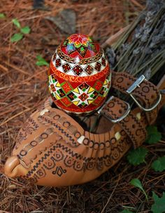 """Ukrainian:  one of my Ukrainian shoes, called a """"postoly"""", that I used to photograph my pysanky egg."""
