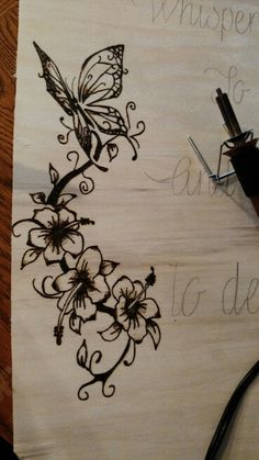 Close up if that butterfly quote order, wood burned flowers and butterfly