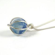 Unusual Cyan and Cobalt Blue Sea Glass Marble Locket Necklace - online now at www.thestrandline.co.uk #handmade #seaglass #necklace #jewelry #thestrandline #northumberland #madeinuk #madeinengland #madeinbritain #seaglassjewellery #giftguide #jewelrygram