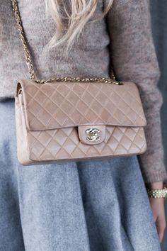 Sweet and feminine beige Chanel bag. You can't go wrong with a diamond stitched Chanel shoulder bag. So many colors to choose from, we'll leave it up to you to decide on ShopStyle.com!