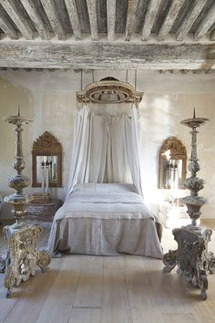 French Bedroom: Canopy, linens, mirrors, plaster elements, distressed timber and wood floors - James Balston Photography