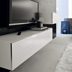 White with aluminum trim. Wall Candy, Media Unit, The Unit, Shelves, Flooring, Mirror, Wood, Furniture, Wall Units