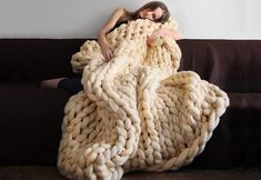 The Chunky Crochet Blanket in natural creamy vanilla is made from super soft hand spun merino wool that is undyed and organic to keep you cozy-warm!