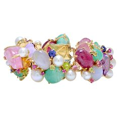 "One of a kind multi gemstone bracelet created by Cluster in the 1950s/1960s. This contains a multitude of gemstones including: sapphire, ruby, tourmaline, emerald, beryl, aquamarine, pearl, citrine, amethyst, etc. all set in a handmade 14K mounting, fits a 7"" wrist generously. poa"