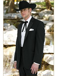 Classic Western Cowboy Tuxedo in Black. All you need is to put on a hat, and throw on your bolo tie and you'll be good to go! Pants come 6 inches smaller than jacket, and can adjust 2 inches out or 4 inches in. #PromTuxedo #Tuxedo #BlackTuxedo #WeddingTuxedo #PromTux #WeddingTux #Tux #Wedding #Prom