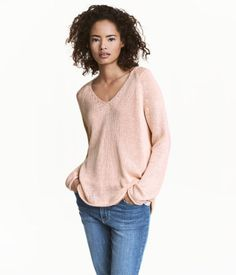 Khaki green. Soft knit sweater with a V-neck, long sleeves, and gently rolled edges.