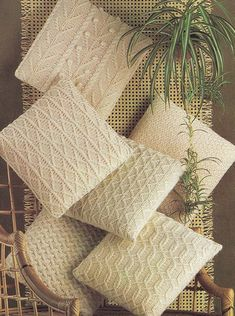 6 different knitting patterns for cushion covers or pillows in the fisherman or aran cable knit style #knitting