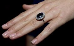 A close up of Kate Middleton's engagement ring as she poses for photographs in the State Apartments with her fiance Prince William of St James Palace on November 16, 2010 in London, England