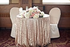 Sweetheart table with blush sequin tablecloth
