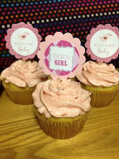 Strawberry buttercream frosting on top of vanilla cupcake
