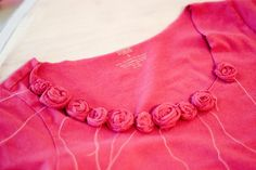 add rosettes to an unfinished collar.