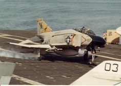 An F-4N Phantom II of Fighter Squadron (VF) 21 records the 300,000th trap on board the carrier Coral Sea (CV43) steaming in the Western Pacific on October 18, 1981