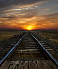 Sunrise over train tracks - every town, large or small, had railroad tracks and the train came to town several times a week or every day. The trains hauled people as well as the products from the farm.