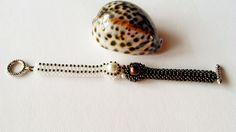 brown--white craw bracelet