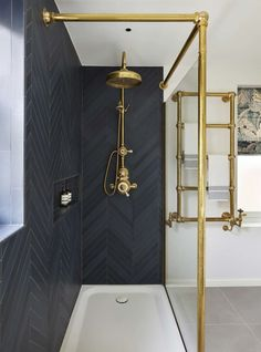 Black bathroom with chevron tiles