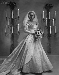 Catherine Murray married William H McManus in November 1948 in the most gorgeous Ceil Chapmanwedding dress. With elegant long sleeves, a beautiful wide almost cowl neckline and an exquisite lace skirt under a layer of sumptuous taffeta, it could easily have been designed for a royal bride.