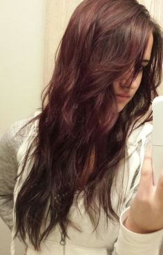 Purple burgundy with dark brown underneath. Long layered hair. love thiss