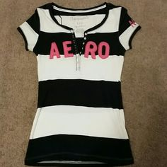 Aeropostole Striped Top Aeropostole striped navy and white top. With Aeropostole ' s logo Aero written in pink. I have worn this shirt twice. Aeropostale Tops Tees - Short Sleeve