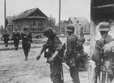 German soldiers crossing the road on the outskirts of Stalingrad.