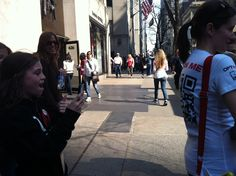 Consumers stopped members of the Optifog team to scan the QR codes on the back of their t-shirts while in New York