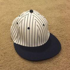 Navy blue and white baseball cap Striped navy blue and white baseball cap Accessories Hats