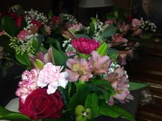 Shades of pink table centerpieces with lilies, Alstroemeria, lemon leaf, seeded eucalyptus, carnations