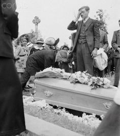 Original caption: France: He Died For France. A grief stricken father stands at the grave of a young boy who gave his life in the fight to liberate France from Nazi domination. When liberating Allied forces invaded French shores, the natives, young and old alike, took up arms and joined the Allies to save their country. This boy paid with his life.
