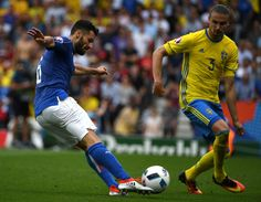 Italy's midfielder Antonio Candreva (L) and Sweden's defender Erik Johansson vie for the ball during the Euro 2016 group E football match between Italy and Sweden at the Stadium Municipal in Toulouse on June 17, 2016. .Italy won the match 1-0. / AFP / PASCAL GUYOT
