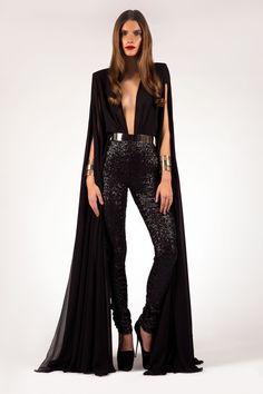 Cape sleeve jumpsuit with strong shoulders & matte sequin beaded pant bottoms. Jewelry cuffs & bar belt not included. Email info@shopcostello.com to ask about color options.- Michael Costello US Size Chart- Terms / Conditions- Shipping- Made to order- Include inches of heels when selecting height- Dry clean only- Thinking about custom measurements? Ask us about custom options custom@shopcostello.com