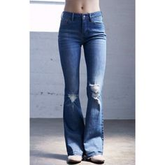 P.S Erin Wasson high waisted blue jeans Gorgeous jeans! I bought two pair in different sizes and the other pair fit me better! Size 27! Has button closure as shown in picture but you can only see one button while wearing like the model pic! Bottom flares! Brand new with tags! Make an offer! Got from pac sun! PacSun Jeans Flare & Wide Leg