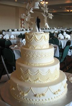 My cake topper is very similar to the one on this cake.  Like this a lot - except for detailing looks too yellow.  Also, like the size and proportion of top three layers.  Would take off bottom layer b/c its too big, but would replace detailing that is on the third layer from the top with detailing that is on the bottom layer.