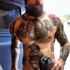 Love, love, LOVE a man with a beard and tattoos! :) especially sailor jerry tattoos .. Drool