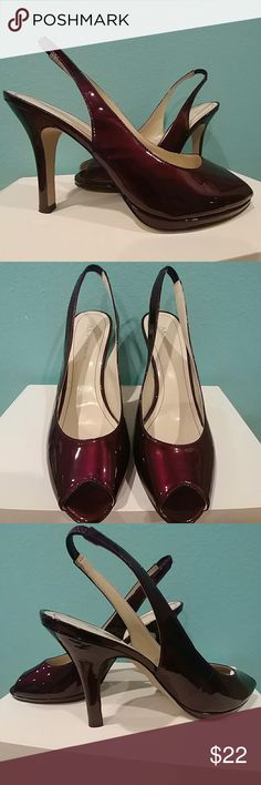 Anne Klein deep red wine red peep toe heels Deep beautiful red wine color, Worn 2 times, in great condition. Leather upper, manmade sole. Tiny scuff marks throughout the shoes here and there, but only really noticeable when polishing and clean the shoes. Heels are in excellent condition, no hits. Anne Klein Shoes Heels