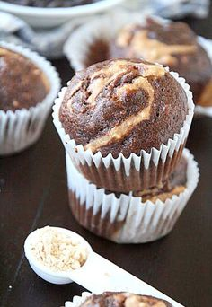Easy banana muffins swirled with melted dairy free chocolate chips and Healthy enough for breakfast, but delicious enough for any time of the day! Healthy Baking, Healthy Desserts, Delicious Desserts, Yummy Food, Healthy Food, Healthy Recipes, Dinner Healthy, Pb2 Recipes, Muffin Recipes