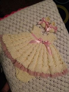 antique white outfit with pink trim and lace.