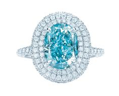 Tiffany platinum and gold diamond ring. Among them, the rarest is the one named Tiffany Anniversary Blue. It is a brilliant color green blue diamond. Platinum ring support is surrounded by and inlaid with dazzling white diamonds. Tiffany Jewelry, Tiffany Rings, Tiffany Necklace, Bling Bling, Tiffany & Co., Tiffany Outlet, Tiffany Stone, Do It Yourself Jewelry, Anniversary Rings