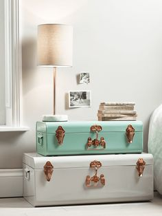 The perfect decorative accessory for your lounge or little one's room, this set of two metal trucks contains two sizes, each in a different colour. The smaller of the set is a soft eau de nil colour and the large a muted putty, and each has copper coloured fastenings and a decorative handle detail. Display separately or stack together for storage that looks truly fabulous.
