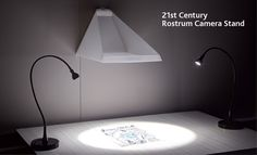 21st century rostrum camera stand - I would like to get one of these rostrum camera stands.  They hand on the wall and you place your iphone camera on top.  How clever.