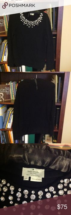 "Kate Spade ♠️ embellished sweater Crew neck Kate spade black sweater with embellished jeweled neckline.  Size medium.  Some pilling in front. 53%polyamide, 47% wool.  Falls about 1-2"" below hip and I am 5'6"".  Love this sweater, but crew necks do not look good on me. kate spade Sweaters Crew & Scoop Necks"