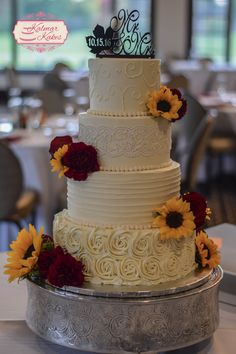 Fall buttercream wedding cake with sunflowers, lace, and roses