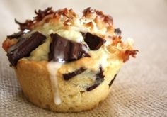 Coconut cupcakes with chocolate chunks and coconut drizzle by lydia